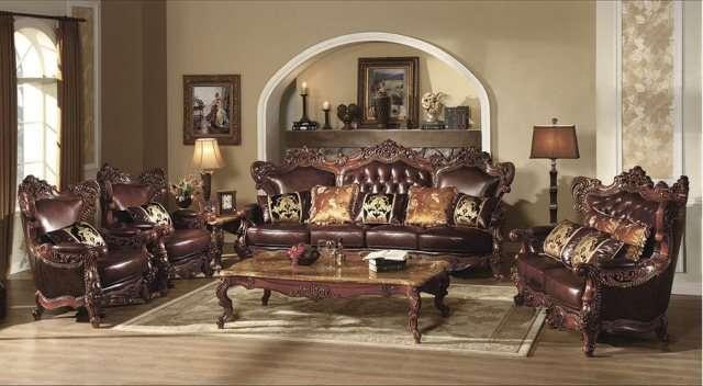 Большой темный кожаный диван с креслами Генрих.